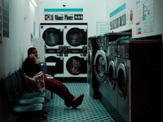woman sitting inside laundry shop